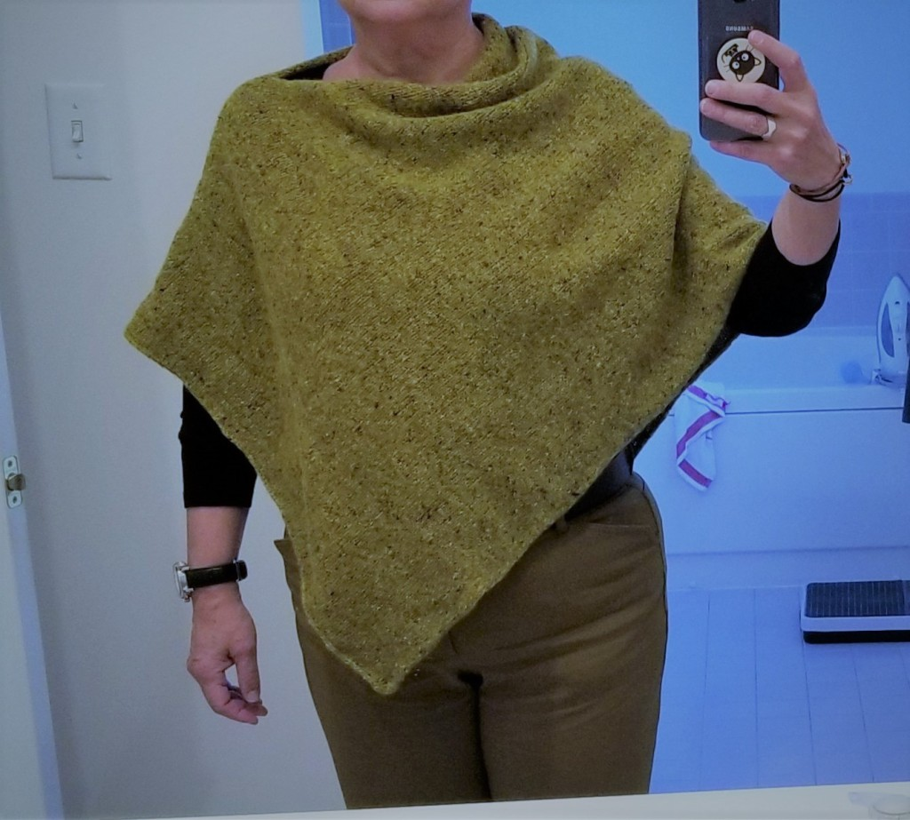 green poncho modeled by me